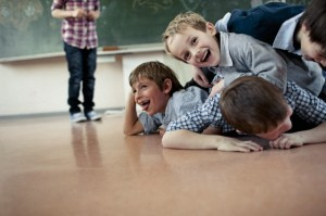 Group of schoolchildren (6-7) playing in classroom